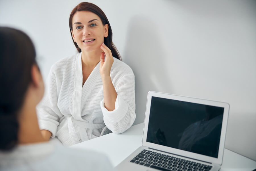 smiling-woman-listening-attentively-to-a-doctor